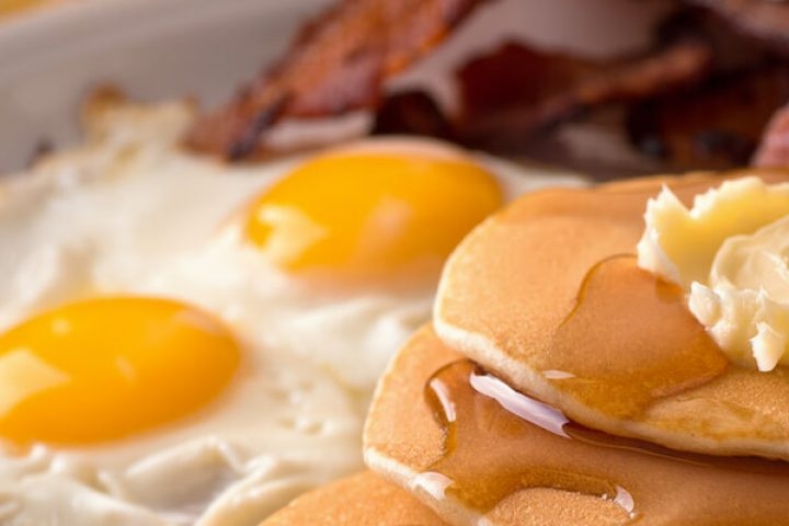 breakfast food: eggs, pancakes, bacon